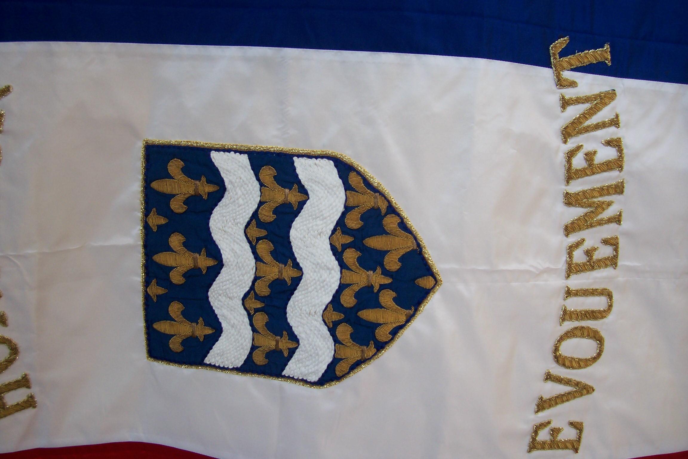 Ecu réappliqué sur drapeau nettoyé